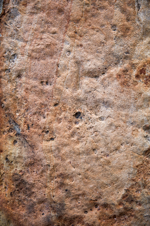 Closeup of the red rough stone wall Stock Photo