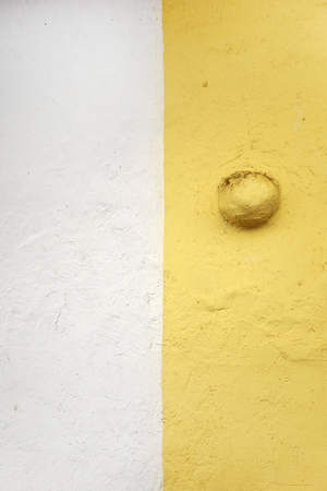 Closeup of the two tone yellow and white concrete wall Stock Photo