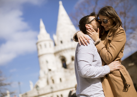 Hugged loving couple by the Fisherman's Bastion in Budapest, Hungary Reklamní fotografie - 115566088