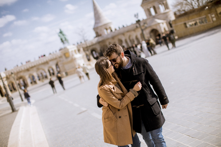 Hugged loving couple by the Fishermans Bastion in Budapest, Hungary