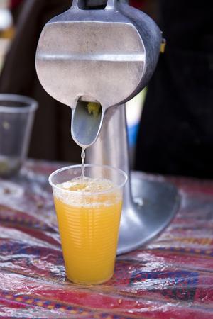 Close up of squeezing fresh orange juice