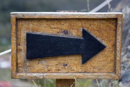 Closeup of the old wooden arrow sign 스톡 콘텐츠