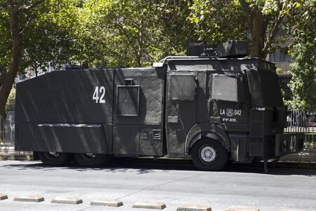SANTIAGO, CHILE - JANUARY 17, 2018: Water cannon truck Mercedes-Benz Rosenbauer RWD-12200 Guanaco of Carabiniers of Chile on the street of Santiago, Chile. Carabiniers are the Chilean national police force formed at 1927.