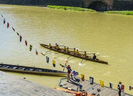 FLORENCE, ITALY - APRIL 7, 2018: Unidentified members of Florence rowing club training on Arno river in Florence, Italy. Rowing club Societa Canottieri was founded in 1886. Sajtókép