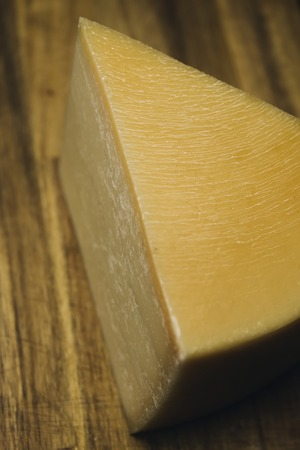 Traditional Auvergne cheese on the wooden table Stock Photo