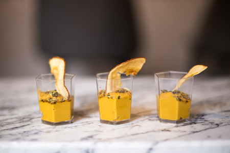 Fresh homemade pumpkin mousse or cream in glasses sprinkled with cinnamon