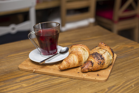 Cup of tea and croissants served for breakfast