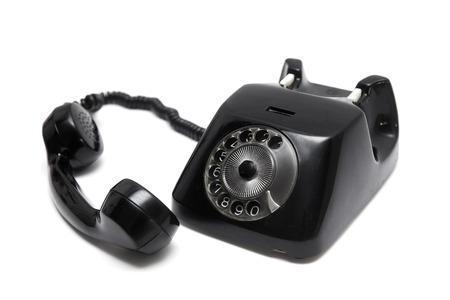 Black vintage telephone  isolated on the white background