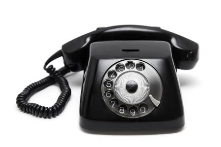 Teléfono vintage negro aislado sobre fondo blanco. Foto de archivo