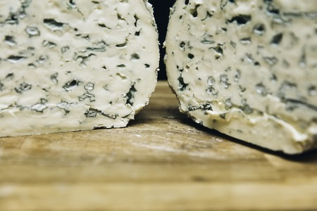 Detail of the mild blue Auvergne cheese Fourme d'Ambert from France Stock Photo - 117381012