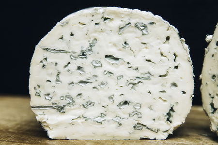 Detail of the mild blue Auvergne cheese Fourme d'Ambert from France Stock Photo - 117638638