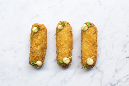 Chicken croquettes appetizers on the table
