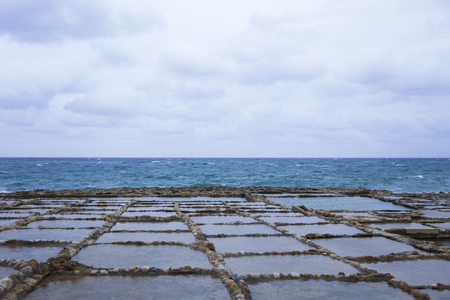 View at Salt Pans on Gozo Island at Malta Foto de archivo