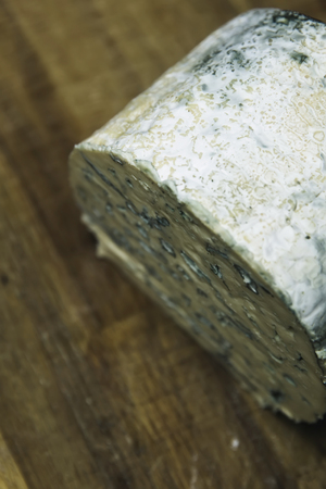 Detail of the mild blue Auvergne cheese Fourme d'Ambert from France Stock Photo - 118565146