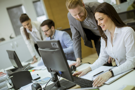 Group of young people working in the modern office