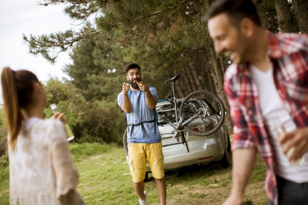 Group of young people enjoying barbecue party in the nature Stock Photo
