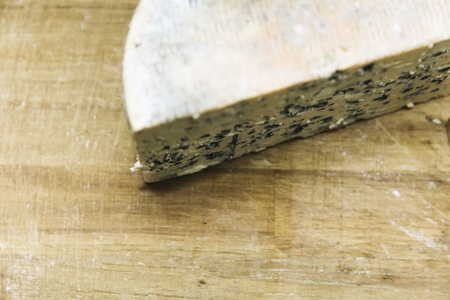 Mild blue Auvergne cheese Fourme d' Ambert from France on the wooden table Stock Photo - 120095862