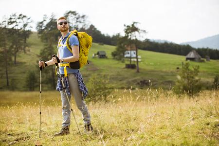 Active healthy man hiking at spring nature Stock Photo
