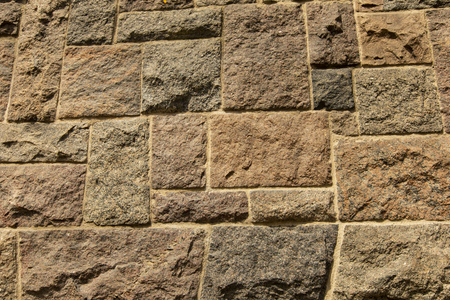 Closeup of the txture of uneven stone block wall Stock fotó
