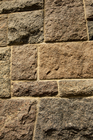 Closeup of the txture of uneven stone block wall Banco de Imagens - 120510320