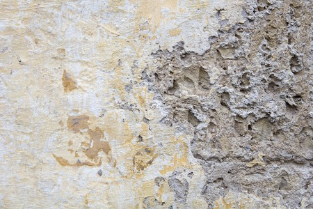 Closeup of the old yellow stone wall texture