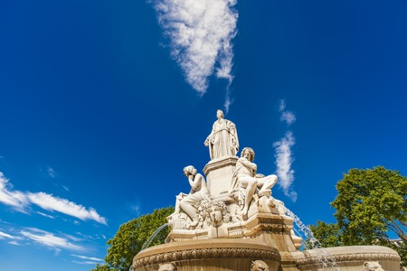 Detail of Pradier fountain at Esplanade Charles-de-Gaulle in Nimes, France 版權商用圖片