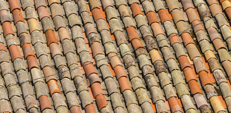 Closeup of the old roof tiles backdrop