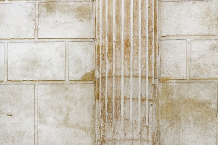 White classical columns and stone wall background Stock Photo