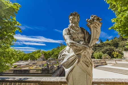 Statue of divinity holding a cornucopia from Les Jardins de La Fontaine in Nimes, France