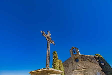 View at iron cross in front of Chapelle des Penitents Blancs in Les Baux-de-Provence, France