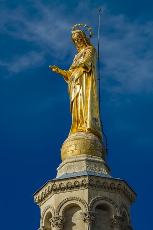 Closeup of statue of Virgin Mary at Notre-Dame des Doms cathedral in Avignon, France