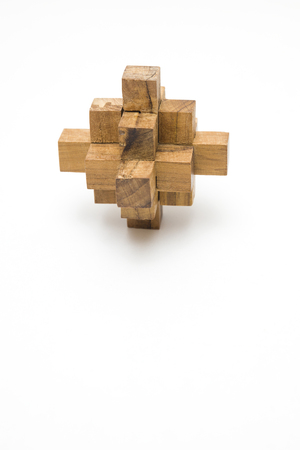 Wooden blocks puzzle toy isolated on the white background Banque d'images - 122619892