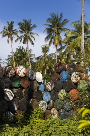 View at old empty metal barrels in the tropical environment Reklamní fotografie