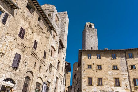 SAN GIMIGNANO, ITALY - APRIL 8, 2018: Detail from the street of San Gimignano, Italy. Historic Centre of San Gimignano is designated as UNESCO World Heritage Site since 1990.