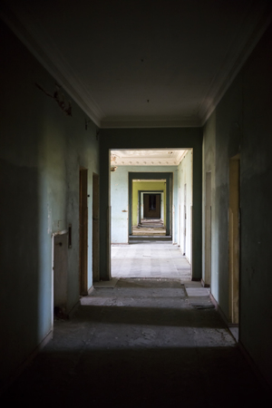 View at ruined hallway in the abandoned building Фото со стока - 123329836