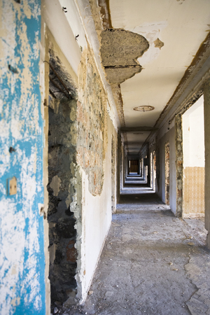 View at ruined hallway in the abandoned building