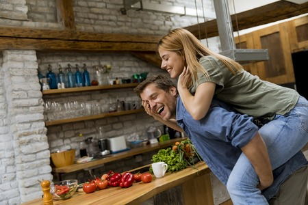 Lovely young couple having fun together at rustic kitchen Banque d'images - 123952077