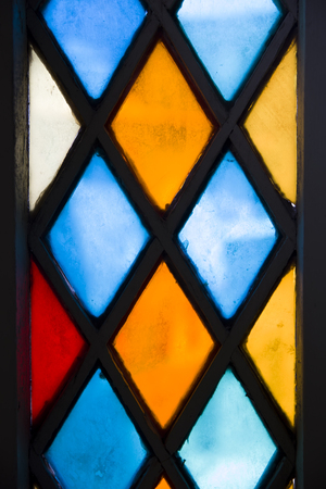 Closeup detail of the colorful stained glass window Banque d'images - 124399862