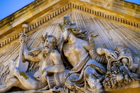 Decorative detail fom facade of 18th century Corn Exchange Hall  building at Place de lHotel de ville in Aix-en-Provence, France