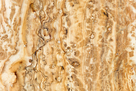 Closeup detail of the natural yellow marble texture background backdrop