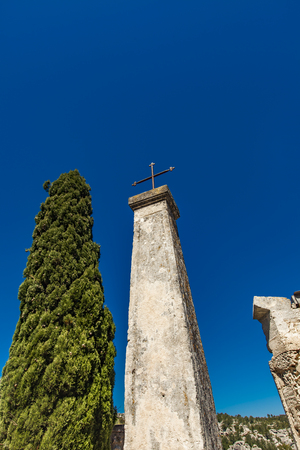 View at cross by cypress tree in Baux-de-Provence, France