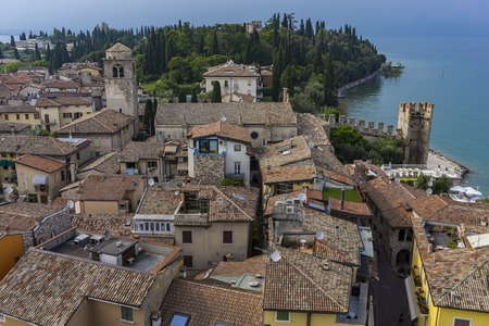 View at small town Malcesine with Castello Scaligero at the shore of Lake Garda, Italy
