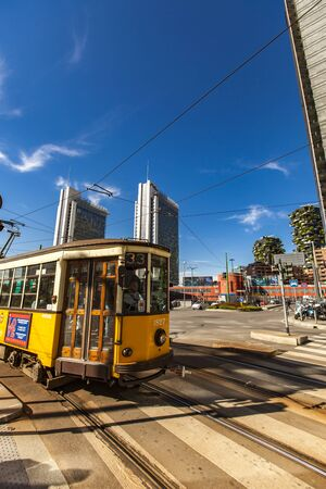 MILAN, ITALY - APRIL 28, 2017: Vintage tram ATM Class 1500 on the street of Milan, near Porta Nuova in Italy. It is a series of tram vehicles constructed between 1927 and 1930.