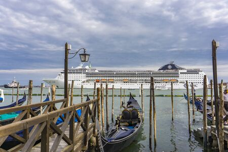 VENICE, ITALY - MAY 26, 2019: View at MSC Opera cruise ship in Venice, Italy. This 13 decks ship was launched at 2004 and have capacity of 2679 passengers.