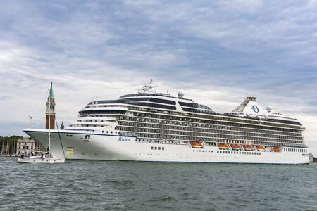 VENICE, ITALY - MAY 26, 2019: View at MS Riviera cruise ship in Venice, Italy. This 15 decks ship was launched at 2011 and have capacity of 1250 passengers.