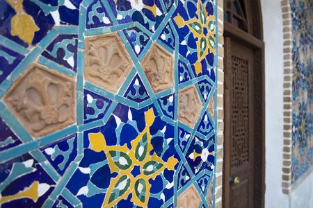 Closeup detail of decorative tiles at facade of the Orbeliani sulphur baths building in Tbilisi, Georgia