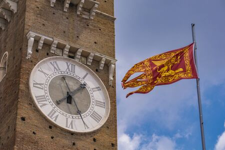 View at Torre dei Lamberti and Venetian Republic flag in Verona, Italy Stock Photo