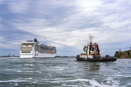 VENICE, ITALY - MAY 26, 2019: View at MSC Magnifica cruise ship in Venice, Italy. This 13 decks ship was launched at 2009 and have capacity of 3605 passengers.
