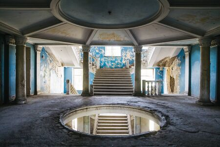 TSKALTUBO, GEORGIA - APRIL 27, 2019: Detail of the abandoned Soviet Sanatorium Iveria in Tskaltubo, Georgia. Tskaltubo was the important spa resort during the Soviet times.