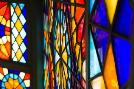 Closeup detail of the colorful stained glass window